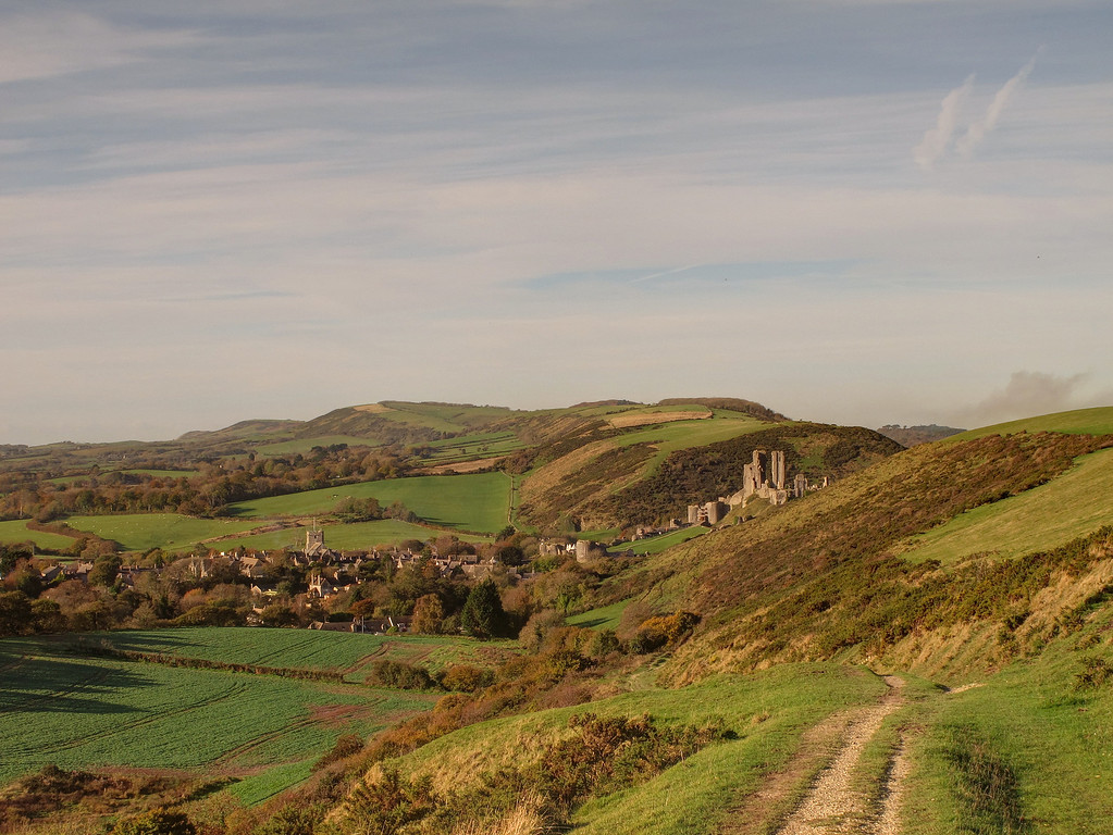 The view back from the access track to the ridge - Corfe Castle and the village basks in the morning sunshine.
