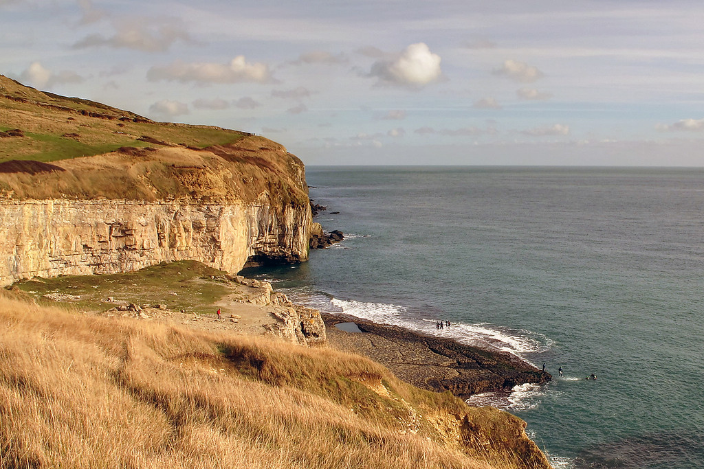 A larger view of dancing ledge; the swimming pool hewn out of the darker rock by quarrymen last century for school children to use is just right of centre.