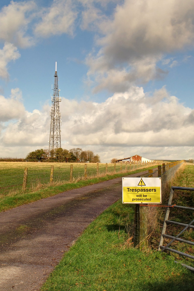 The fill-in TV transmitter on the hill at Bench Tree Farm overlooking Winterborne Stickland.<br /> I'm not sure how effective the sign would be against someone up to mischief.