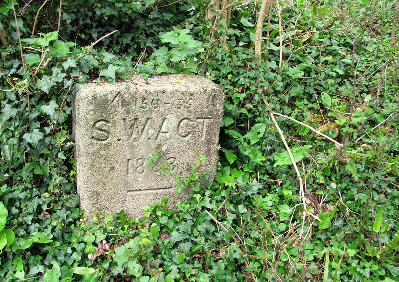 A marker on the Purbeck Way path showing the line of the water supply pipe from a reservoir up in the hill above.     It refers to the Swanage Water Act of 1883.