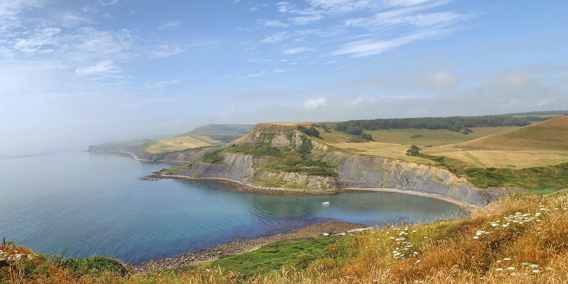 Chapmans Pool with Houns Tout Cliff and Swyre Head beyond.
