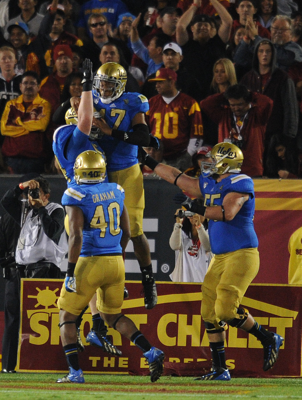 . UCLA QB Brett Hundley celebrates after running in for a touchdown in the 3rd quarter. UCLA defeated USC 35 to 14 in a matchup of cross town rivals at the Los Angeles Memorial Coliseum in Los Angeles, CA.  photo by (John McCoy/Los Angeles Daily News)