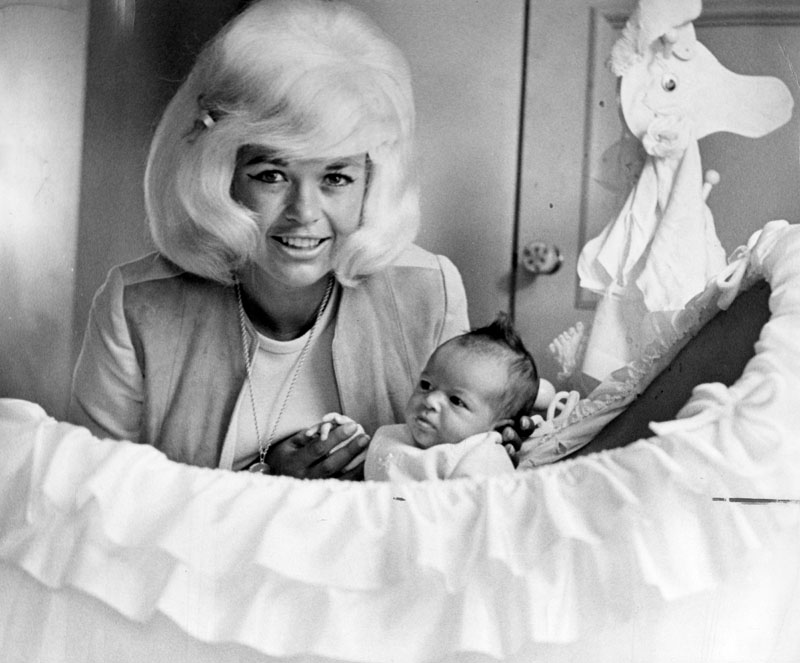 ". Photograph shows Jayne Mansfield and the 35-day-old daughter Mariska Magdolna Hargitay. One of two images featured on the front page of the Valley Times article, ""The Two Lives of Jayne\"". Mariska Hargitay is now an actress, well known for her role as crime detective Olivia Benson on the NBC television drama series, \""Law & Order: Special Victims Unit\"".   (1964)  (Los Angeles Public Library)"