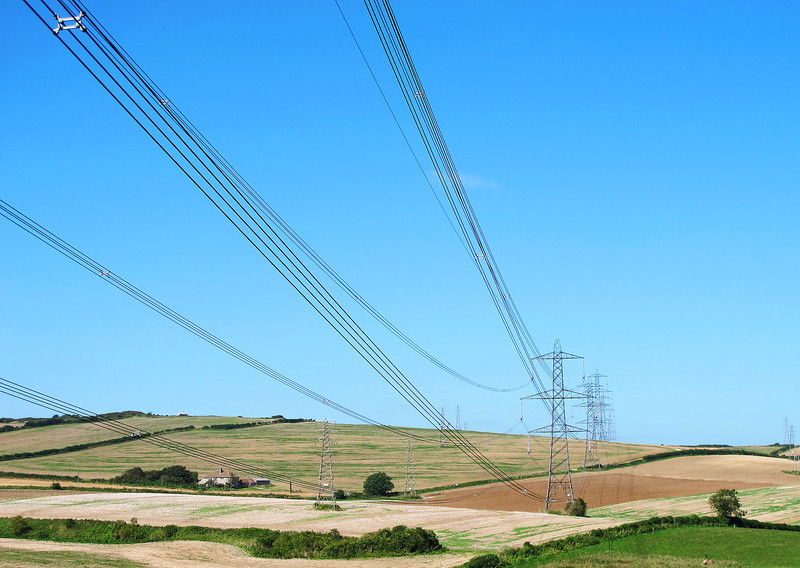 Pylons march across the countryside near Corton Hill.