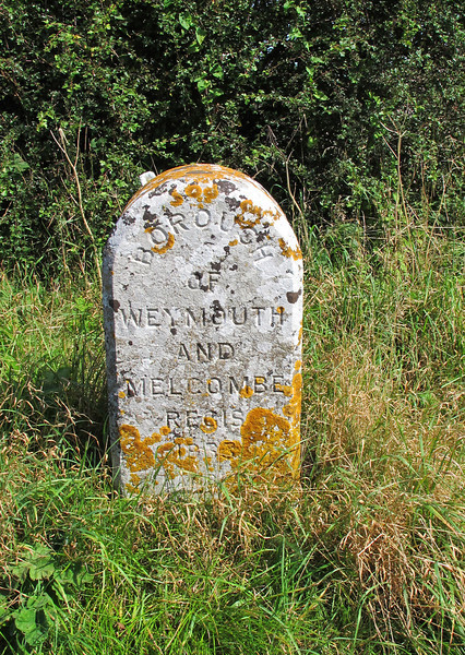 A stone marks the boundary of the Borough of Weymouth and Melcombe Regis near Upwey.