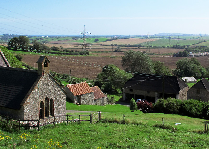 The delightful little chapel at Corton with the bulk of Portland looming on the horizon.