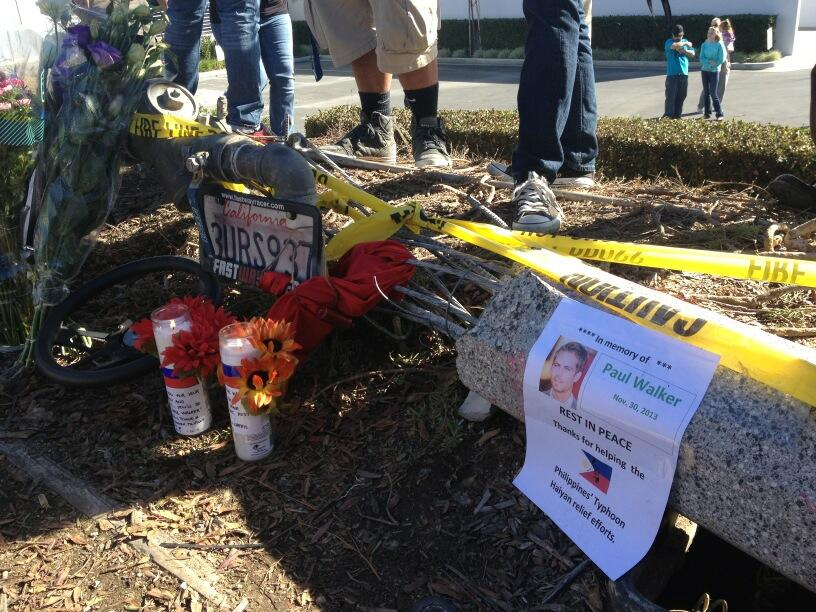 . Scores gather on Dec. 1, 2013, at the Valencia scene where Paul Walker and Roger Rodas died in a Nov. 30 crash. (Photo by Brenda Gazzar/Los Angeles Daily News)