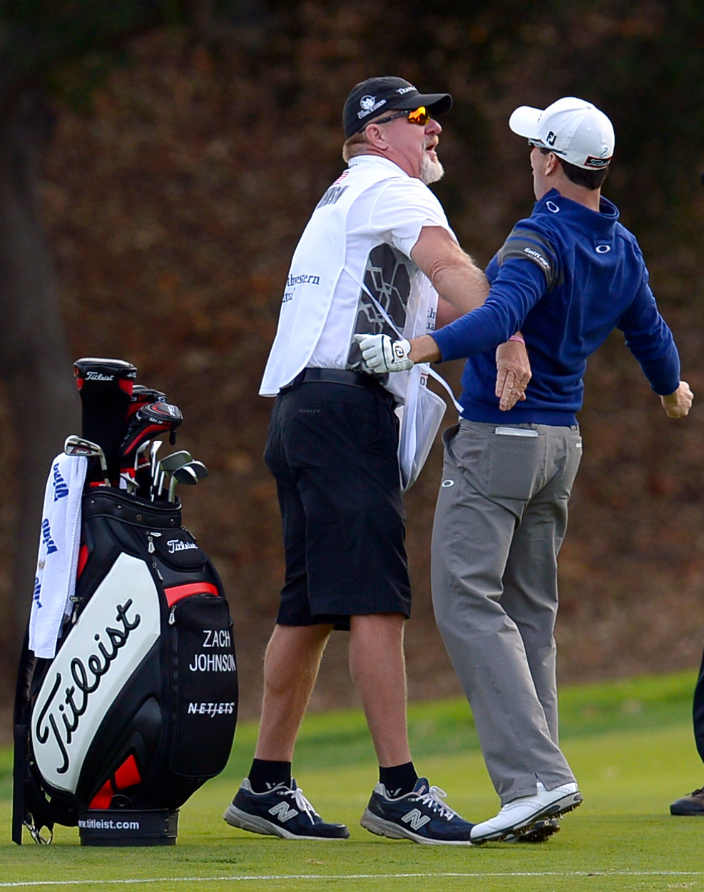 . Zach Johnson and his caddy Damon Green react after Johnson holed out from the drop zone on the 18th hole during the final round of the Northwestern Mutual World Challenge golf tournament at Sherwood Country Club, Sunday December 8, 2013, in Thousand Oaks, Calif.   Johnson would go on to beat Tiger Woods on a playoff hole.(Andy Holzman/Los Angeles Daily News)