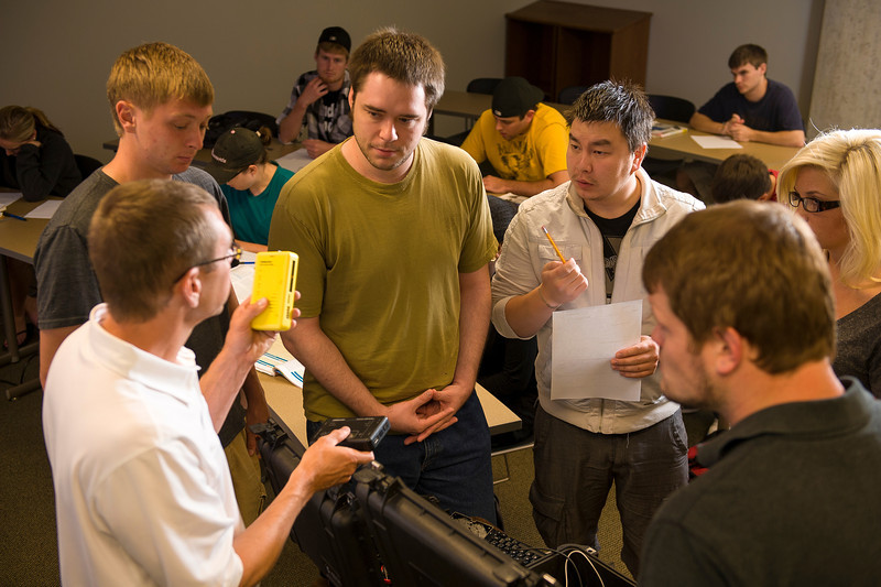 Mark Schmidt, professor of information systems, teaches students in Centennial Hall. Students from left are Matt Sturgeon (West Des Moines, Iowa); Steven Lemma (Maple Grove); Zolboo Yura (Ulaanbaatar, Mongolia); Megan Anderson (Hoffman) and Nathan Savering (Andover).