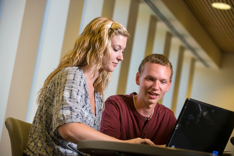Studying on the second floor of the Miller Center are students Brittney Lechner (Waconia) and Neil Hopfer (Richmond).