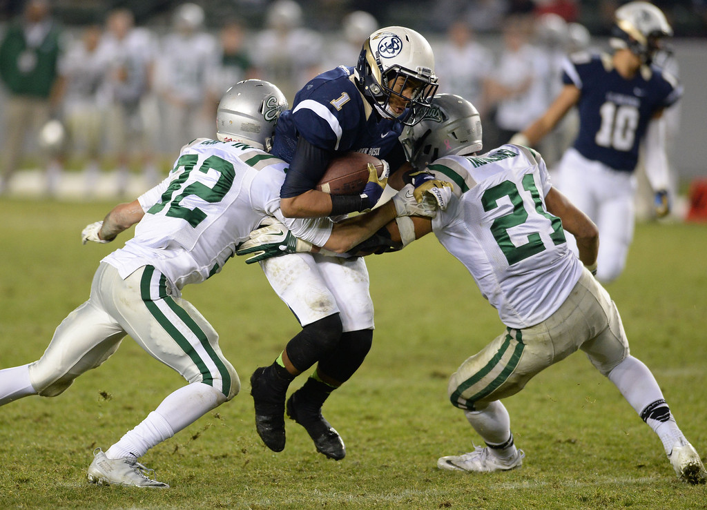 . St. John Bosco\'s Shay Fields (1) tires to slice De La Salle defenders in the CIF State Football Bowl Championships Saturday, December 21, 2013, at the Stub Hub Center in Carson, CA.   Bosco won 20-14. Photo by Steve McCrank/DailyBreeze