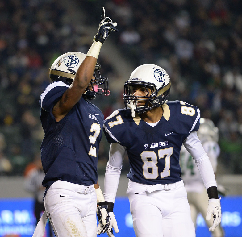 . St. John Bosco\'s Jaleel Wadood (2) celebrates his second first half touchdown against De La Salle in the CIF State Football Bowl Championships Saturday, December 21, 2013, at the Stub Hub Center in Carson, CA.   Bosco held a 17-7 lead at the half. Photo by Steve McCrank/DailyBreeze