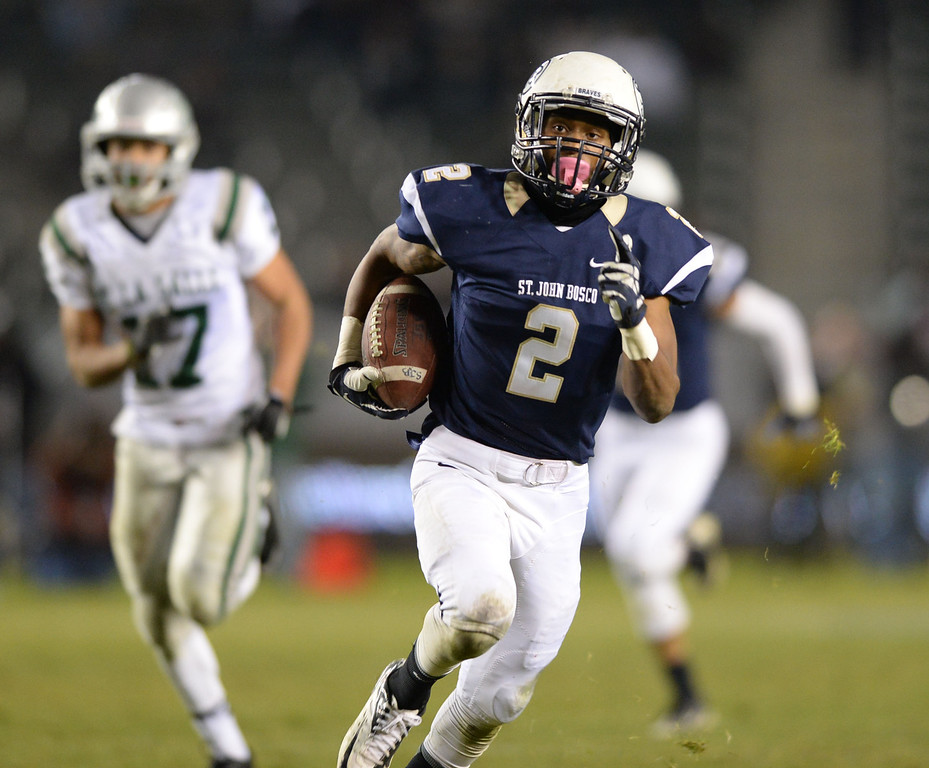 . St. John Bosco\'s Jaleel Wadood (2) receives a pass for a touchdown against De La Salle in the CIF State Football Bowl Championships Saturday, December 21, 2013, at the Stub Hub Center in Carson, CA.   Bosco held a 17-7 lead at the half. Photo by Steve McCrank/DailyBreeze