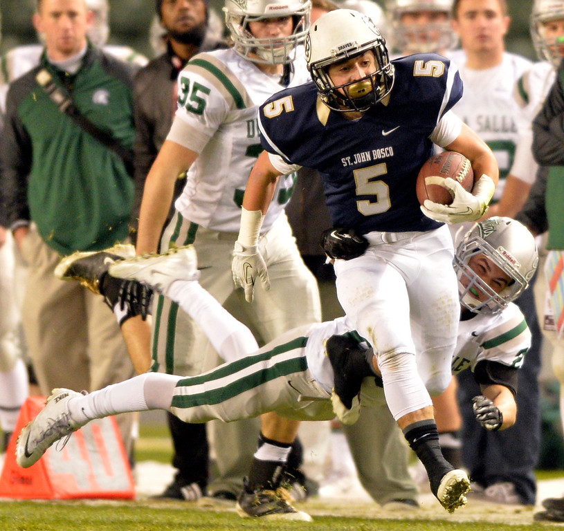 . Bosco\'s Sean McGrew gets tackled by DeLa Salle\'s Vicente Sarver after McGrew ran for a first down during the CIF State Football Bowl Championship in Carson, CA. Saturday December 21, 2013.   (Thomas R. Cordova/Press-Telegram/Daily Breeze)