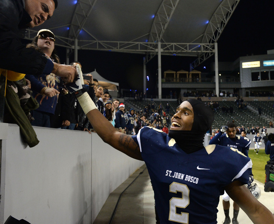 . St. John Bosco\'s Jaleel Wadood (2) shakes hands with fans after beating De La Salle in the CIF State Football Bowl Championships Saturday, December 21, 2013, at the Stub Hub Center in Carson, CA.   Bosco won 20-14. Photo by Steve McCrank/DailyBreeze