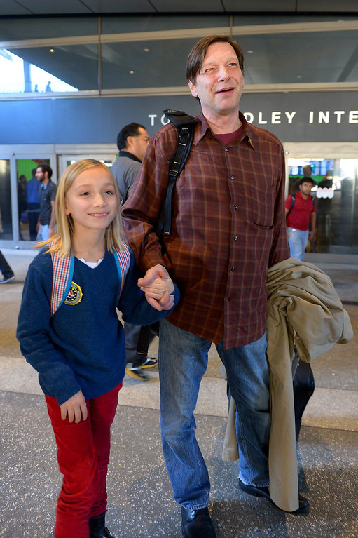 ". Robert Pfeifer walks with his ten-year-old son Robert ""Jerry\"" Pfeifer at LAX after arriving from France, Saturday, December 28, 2013, after a French court reaffirmed his parental custody. The boys\' mother, Maria Pfeifer, is accused of taking her two sons on a trip to Europe in 2012 and never returning, in violation of custody orders involving the boys\' fathers. (Photo by Michael Owen Baker/L.A. Daily News)"