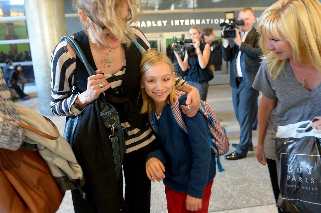 ". Robert ""Jerry\"" Pfeifer, 10, center, is hugged by friend Cynthia Sley as they arrive at LAX from France, Saturday, December 28, 2013, after a French court reaffirmed the father\'s, Robert Pfeifer, parental custody. The boys\' mother, Maria Pfeifer, is accused of taking her two sons on a trip to Europe in 2012 and never returning, in violation of custody orders involving the boys\' fathers. (Photo by Michael Owen Baker/L.A. Daily News)"