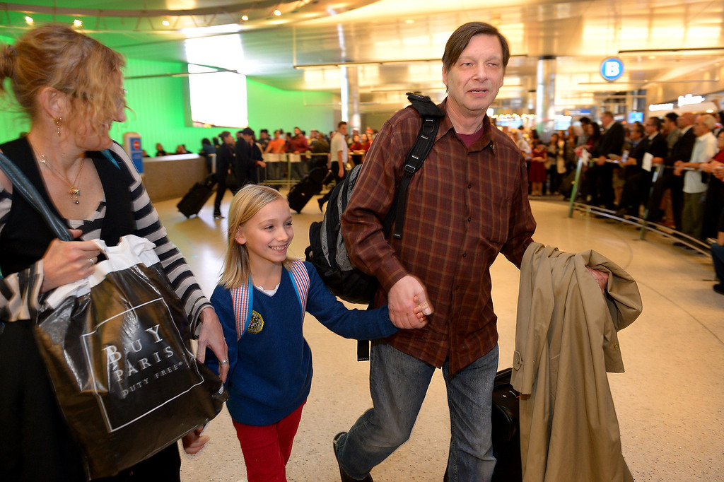 ". Robert Pfeifer walks with his ten-year-old son Robert ""Jerry\"" Pfeifer, and friend Cynthia Sley as they arrive at LAX from France, Saturday, December 28, 2013, after a French court reaffirmed his parental custody. The boys\' mother, Maria Pfeifer, is accused of taking her two sons on a trip to Europe in 2012 and never returning, in violation of custody orders involving the boys\' fathers. (Photo by Michael Owen Baker/L.A. Daily News)"