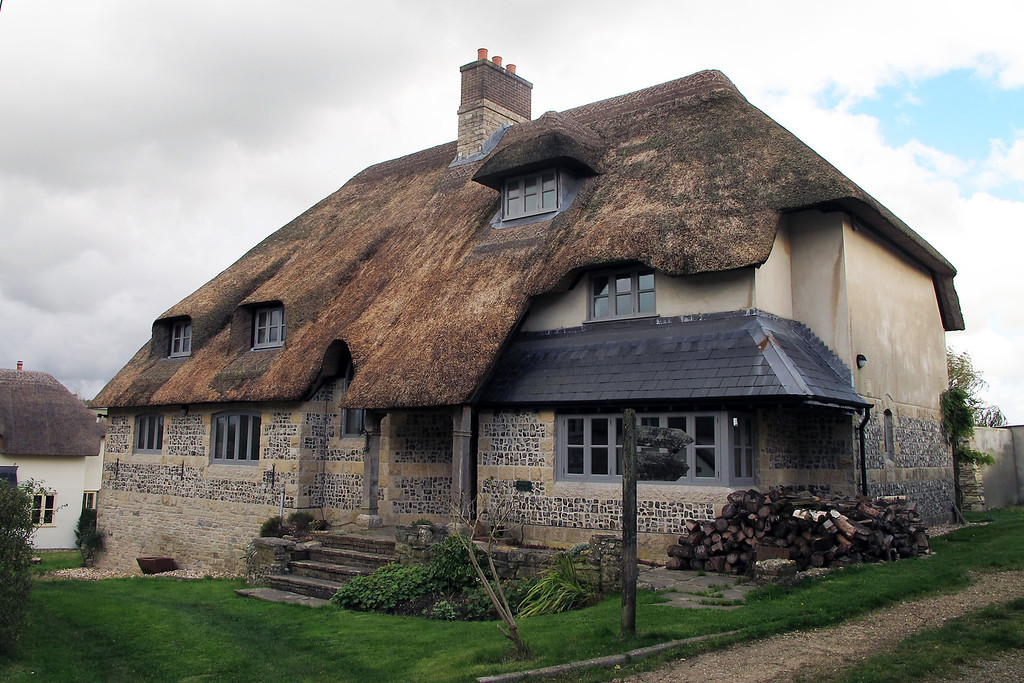 A large modern thatched cottage on the footpath in Melcombe Bingham.