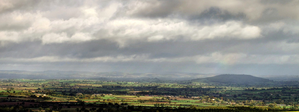 A panorama of the view from Turnworth Down.   The flat topped hill is Duncliffe Hill.