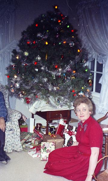 Christmas, 1967:  Mom by the Christmas Tree.