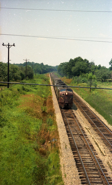 Penn-Central Passenger Train being pulled by Pennsylvania RR E-Units near St. Jacob, IL.