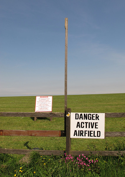 The footpath crosses the runway at Compton Abbas airfield.
