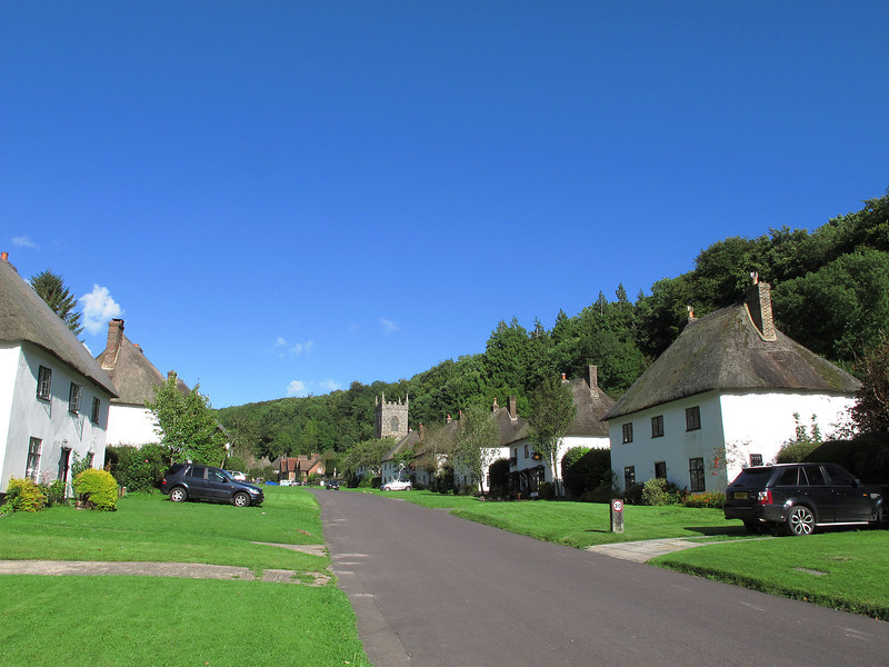 Milton Abbas, where the cottages were quite revolutionary when built by the owner of the estate, who relocated the inhabitants and demolished the old village to form a landscaped area in front of the  'big' house.