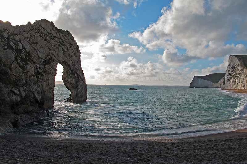 The rock in the centre is called The Bull and beyond is a string of rocks called The Blind Cow, The Cow and The Calf.   Note the small hole (Bats Hole) in the further chalk headland Bats Head.