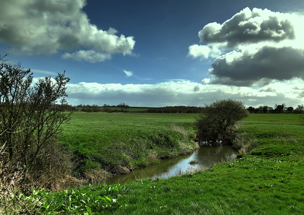 The river Cale meanders across the meadows