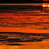 A color image of an orange Assateague Island sunrise on Virginia's Eastern Shore