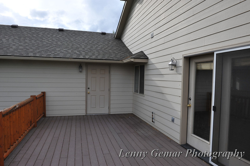 rear deck, looking at garage entrance, with kitchen entrance to right.