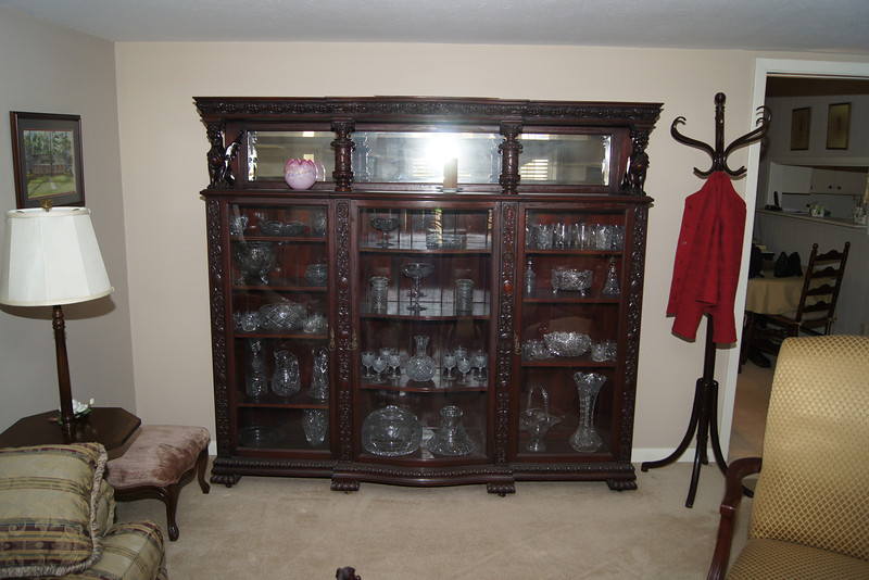 China Cabinet.  My mother would like this to stay with the house.  The contents are up for grabs.