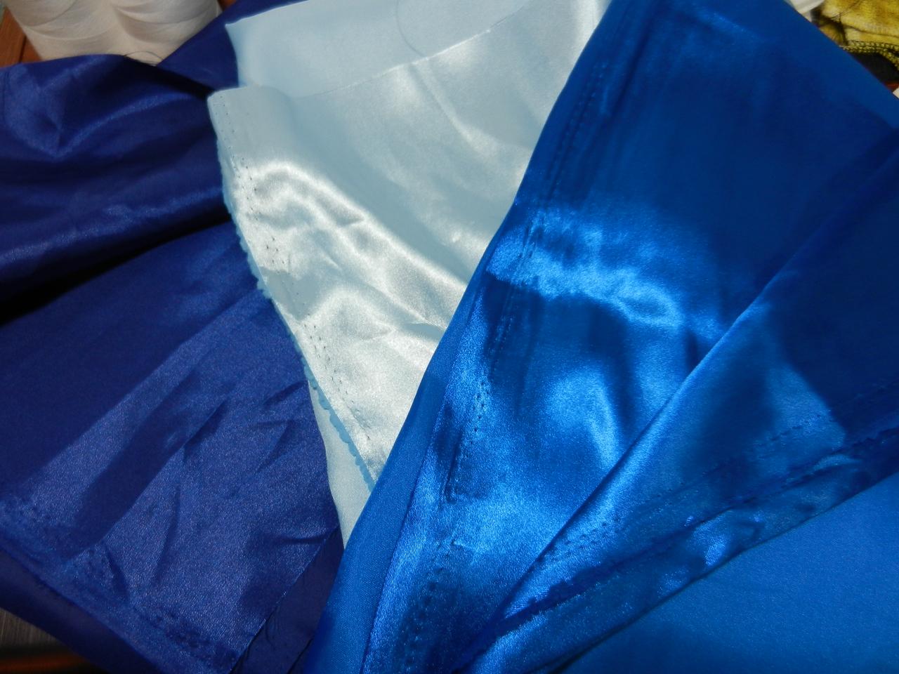 left - darker blue satin - not as shiny middle - light blue satin - shiny right - med blue satin - shiny