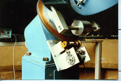 This view shows the huge 359 tooth 15 inch Byers gear mated to a Byers worm assembly.  A heavy duty clock drive makes this telescope move with precision.  A slow motion control device makes the final movements when needed.  Note the clutch centered within the main gear