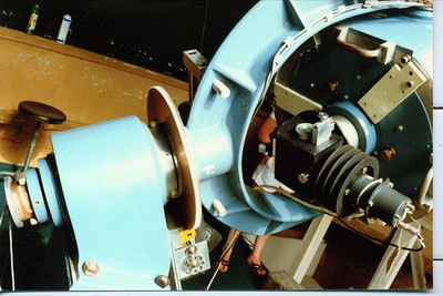 This is a close up of the tailstock for the 18 inch   Ritchey Cretien Reflector.  This f-10.5 instrument has optics made by famous telescope maker Richard Brandt.  The story was as I was told -  Coulter Optical's Jim Jacobson wanted to build an impressive optical instrument, using the best design and optics. He demanded observatory quality .  Hence the Ritchey-Cretien optical system was used. Jim wanted a special custom mount to go with it. The mount was to be stable and easy to use  -- that made the fork equatorial a good choice. Starting from scratch it became a fabulous instrument!!  ( Click on any image to enlarge it. )