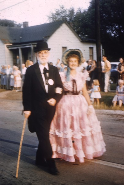 Former Mayor Raleigh R. Moore, escorted by Jana Lee Wheeler.