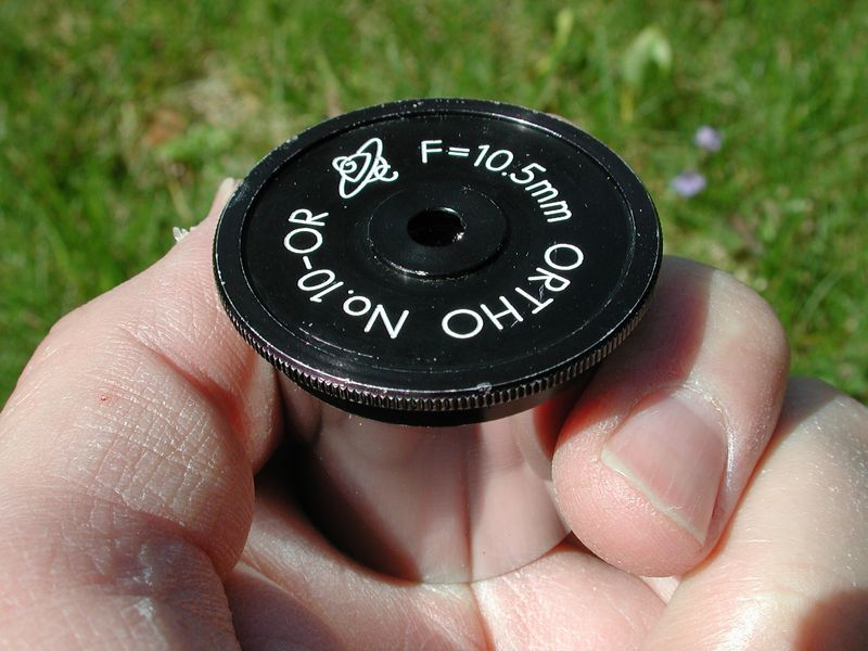 This is an original eyepiece that came with the Cave Telescope. Orthoscopic 10.5 mm eyepiece with a 50 degree field of view.  All glass air surfaces are hard coated to improve light transparency and are true Orthoscopic in design, having a triple achromatic field lens and a single eye lens.        This occular is a fine example of a quality eyepiece of its day and made in Japan. Quite heavy by todays standards and in very good to excellent condition. The barrel of this example is in especially fine  shape.
