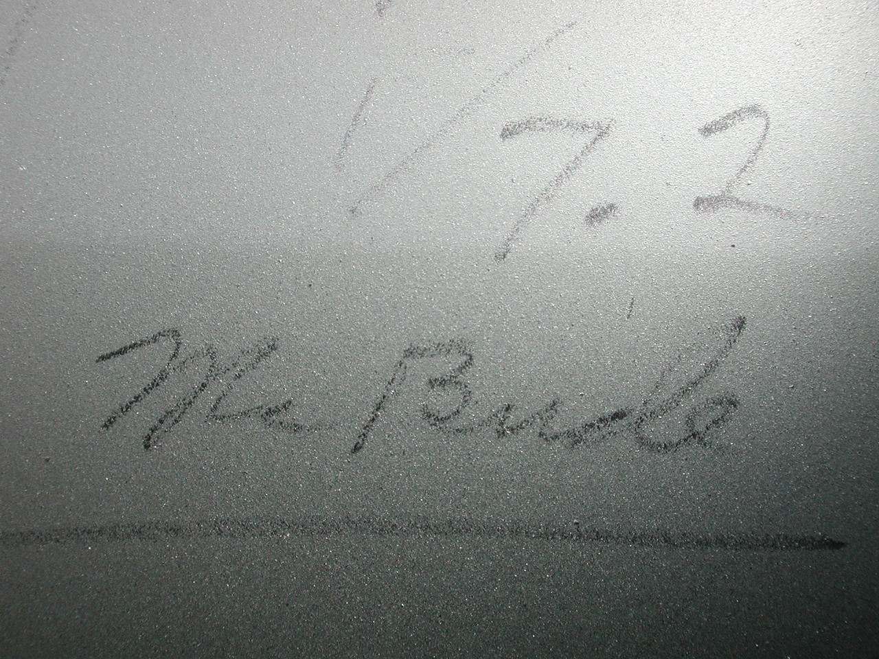 "The pencil writing on the mirror's back reads "" 1/7.2 "" but the name following is not as clear. Perhaps "" Mr. Bude"" or "" Mr. Burle""  ??"