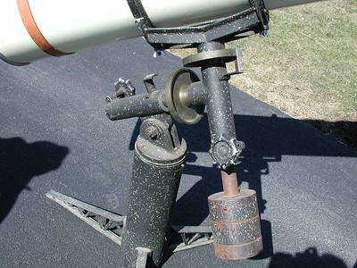 """Close-up of the Equatorial mount. In this photo you can see the famous black with """"white speckles paint"""" job trade-mark of early Cave instruments. Note the big locking knobs on both axises and the brass setting circles.  In this image polar axis is not quite pushed down all the way into its housing."""