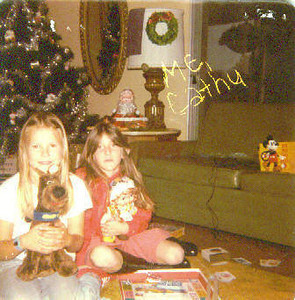 Cathy Stolins and a moody Christy Nebeker who is holding a doll she wasn't too happy about getting (Mom trying to turn me from being a tomboy I guess). 1978