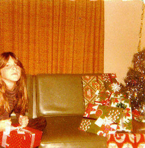 Christy Nebeker; Christmas morning 1978 [This was the Christmas I was getting tired of getting dolls (there's one of many in that box I'm trying to open); didn't get the skateboard and radio I wanted / I think I was sending a message to my Mom that I had had enough of being treated like the baby girl!]