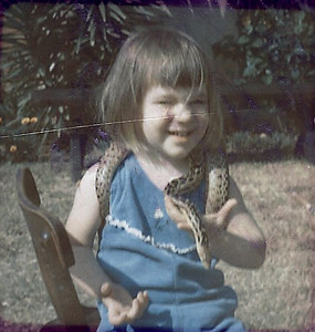 Christy Parker with her brother's garter snake.
