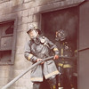 Danbury FD member coming out of the burn house with me behind him.