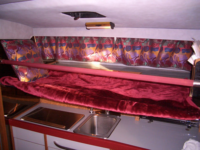 Removable Pipe berth over the galley (mattress not shown)