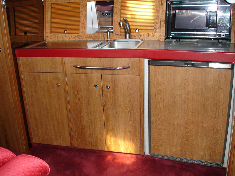 New book-matched teak veneer on all cabinets and doors
