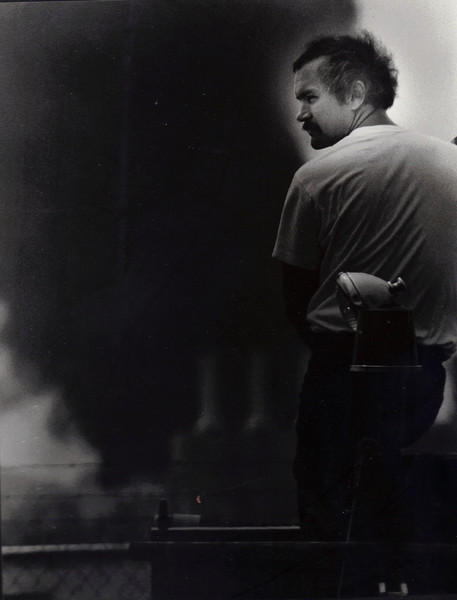 Accidents do happen at the Port of Memphis. June 17, 1987 Mapco Petroleum was damaged by a fire which left one man dead and another  injured. A Memphis fireman monitors the blaze from a pumper on Rivergate Road.