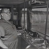 When he was fifteen Thomas Smiley began working on the river. That was 1942. Today Captain Smiley is responsible for everything that happens on his boat. Smiley pauses in front of the controls in the modern pilot house