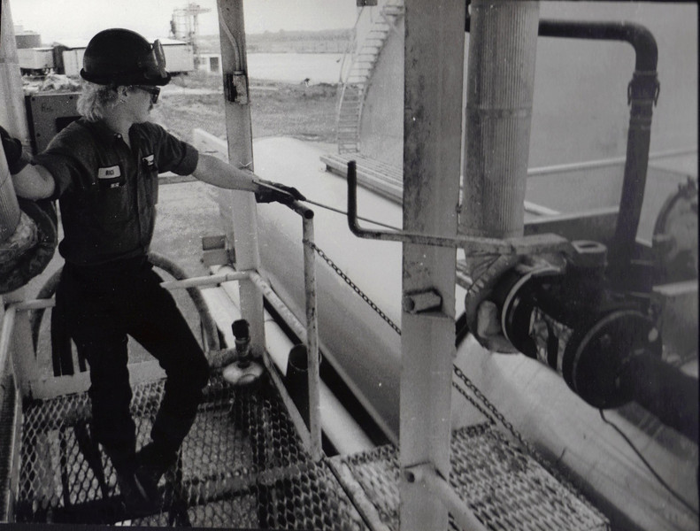 Trucks carry shipments to the last mile. Rick O'Neil of Chemtech loads a caustic solution into a tanker truck at the plant.