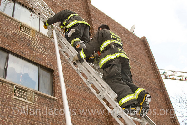 CFD E-55 Fireman Sid Bleustein and back-up. Note whit socked foot on his hip